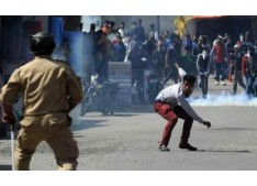 Youth killed, 10 cops among 22 injured in clashes