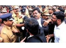 Scuffle breaks out between cops, lawyers: Govt vehicles set on fire, Gunshots heard