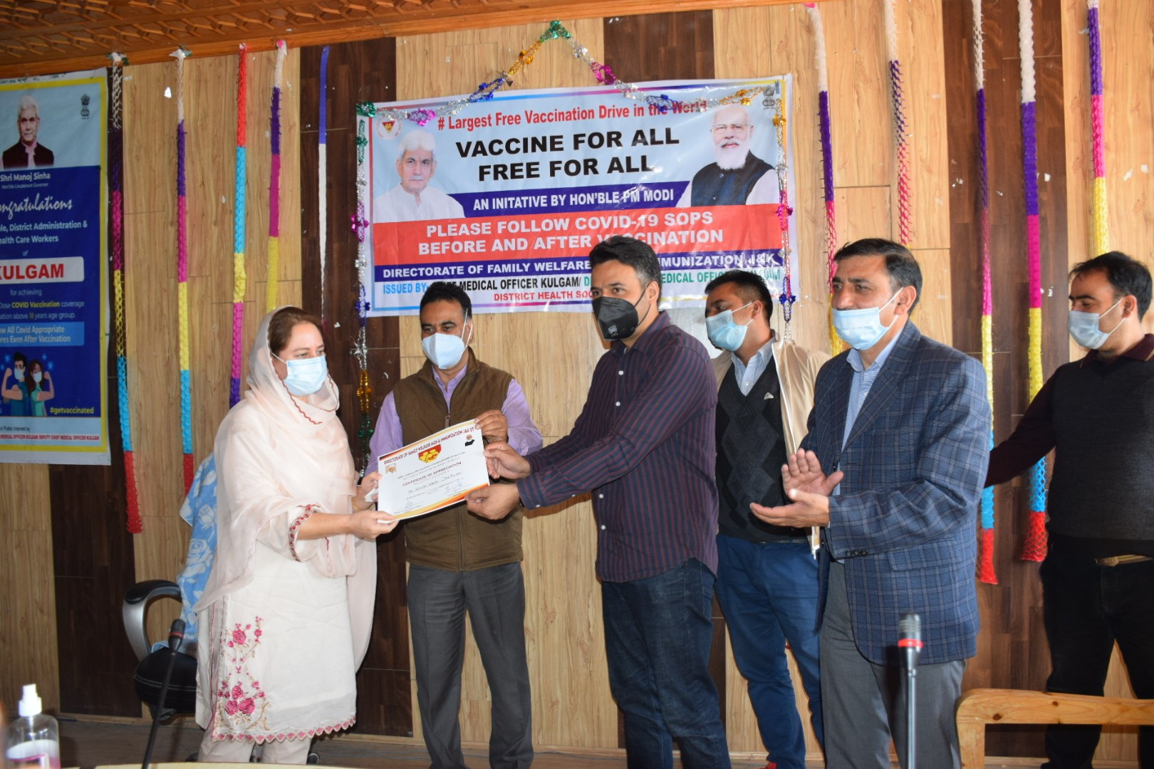 DC Kulgam felicitates health care workers for 100 percent vaccination